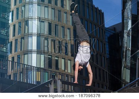 Young Man Doing Handstand In The City