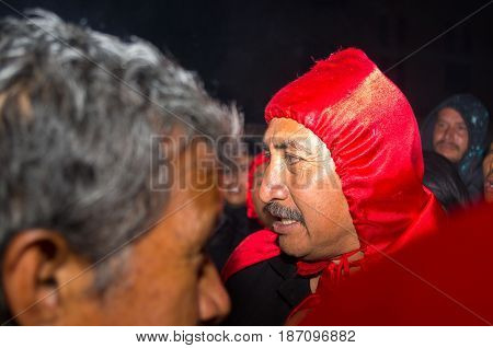 Quito, Ecuador - May 27, 2015: Close up of an unidentified man wearing a red Hood.
