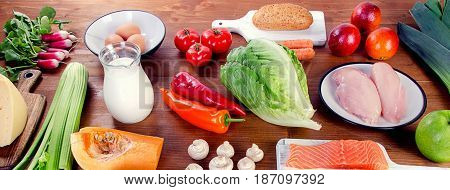 Vegetables, Fruit, Fish, Milk And Meat On Wooden Background. Balanced Diet.