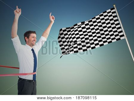 Digital composite of Business man at finish line against blue green background and checkered flag