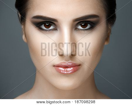Beautiful Face of Young Woman with Clean Fresh Skin close up on gray. Beauty Portrait. Beautiful Spa Woman Smiling. Perfect Fresh Skin. Pure Beauty Model. Youth and Skin Care Concept