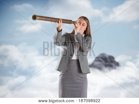 Digital composite of Business woman with telescope against mountain peak in the clouds