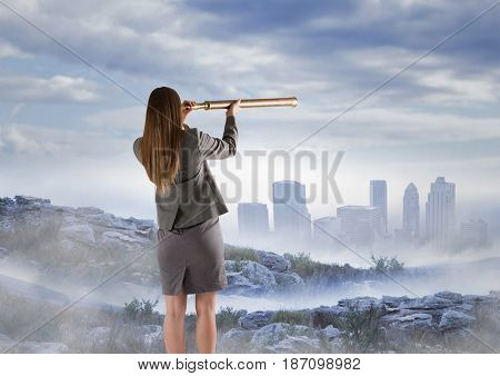 Digital composite of Business woman observing skyline with telescope from misty mountain peak