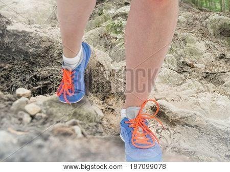 Digital composite of Legs Walking or jogging on rough nature terrain