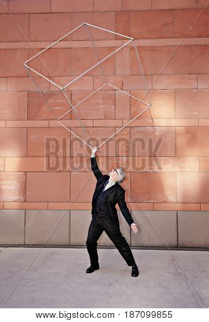 Caucasian businessman lifting metal box