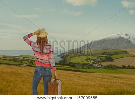 Digital composite of mountain travel,woman with hand bag and hat