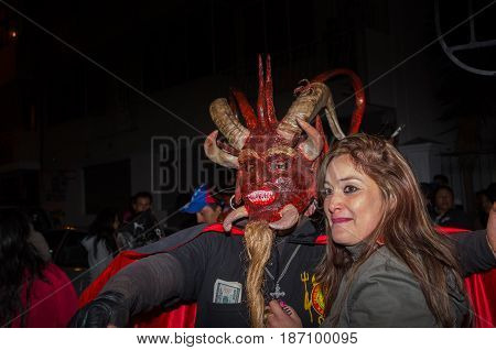 Quito, Ecuador - May 27, 2015: Close up of a couple in the diablada.