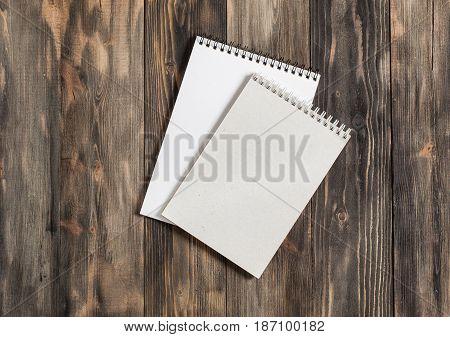.mock Up. Notebook Or Sketchbook On Dark Wooden Table...
