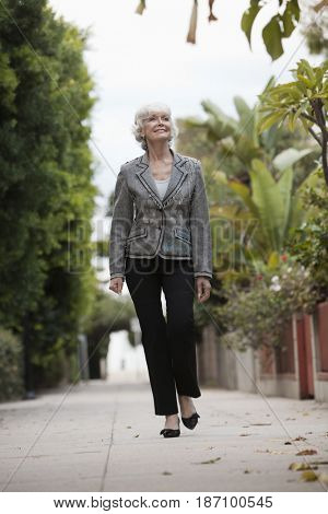 Caucasian woman walking down alley