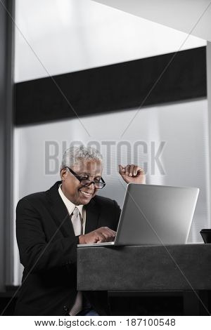 Black businessman typing on laptop