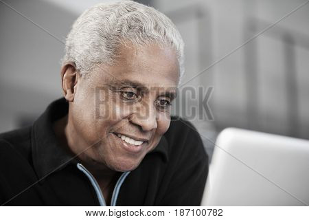 Black man using laptop
