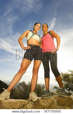 Hispanic women backpacking in remote area