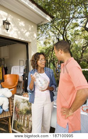 African American woman having a garage sale