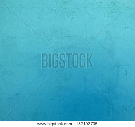 Cyan plaster texture with lot of small cracks. Closeup view of plain surface with random structure. Industrial background with place for text.