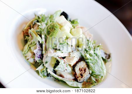 Waldorf salad with lettuce, apple, pickled walnut in a creamy dressing - filter applied