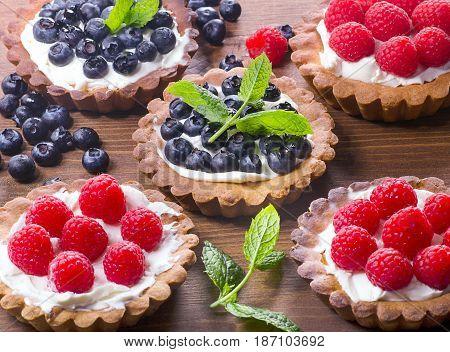 Homemade Tarts With Fresh Raspberries And Blueberries