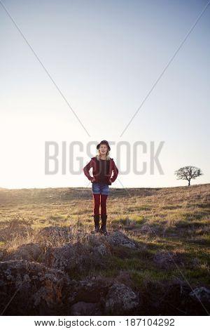 Caucasian girls standing in field