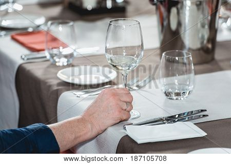 a lot of different wine glasses on the table at wine tasting. sommelier at wine tasting talks about how different food pairs to a different wine
