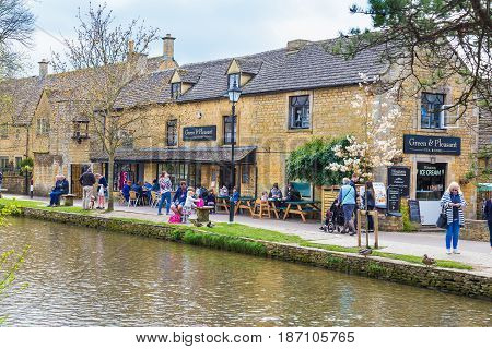 Bourton On The Water England - 7 April 2017 - People enjoy their day along the water on a fine day at Bourton On The Water England on April 7th 2017.