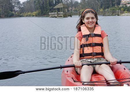 Chilean girl rowing in kayak