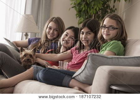 Friends hanging out on sofa together