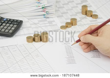 Man Is Auditing Account By Pencil With Step Gold Coins