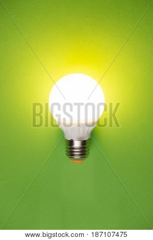glass bulbs for lampson green background - idea concept