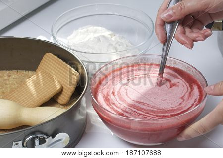 Cheesecake Of Cottage Cheese And Strawberries. Cooking Process. Mixing Of Strawberry Puree And Cotta