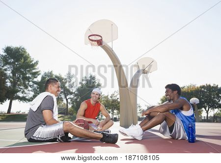 Friends relaxing after playing basketball