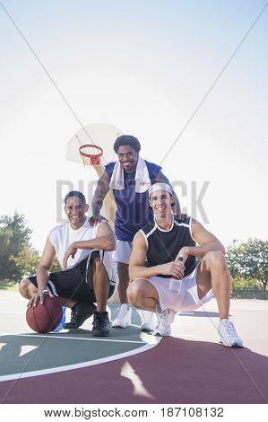 Friends relaxing on basketball court