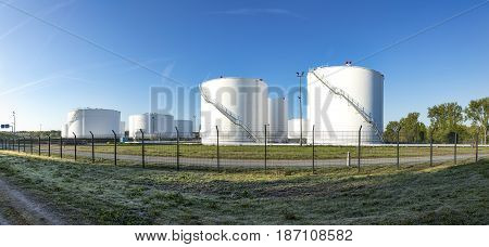 huge white silos in a silo farm with petrol