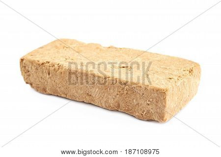 Briquette of a nut halva confection isolated over the white background