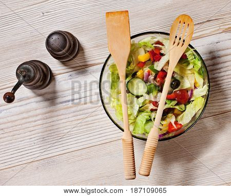 Fresh vegetables salad on white table - top view