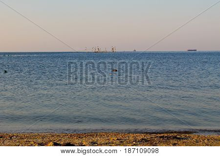 Seascape with fishing nets on a horison
