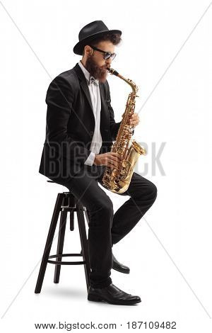 Jazz musician playing a saxophone and sitting on a chair isolated on white background