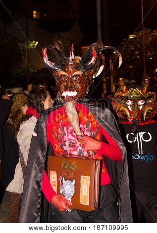 Quito, Ecuador - february 02, 2016: An unidentified people dressed up participating in the Diablada, popular town celebrations with people dressed as demon.