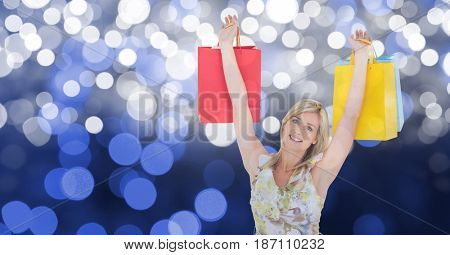 Digital composite of Happy woman with arms raised holding shopping bags