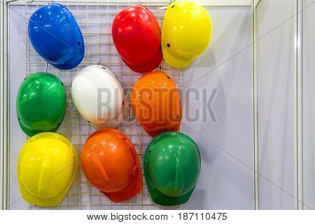 Multi-colored helmet on hanging over the wall.