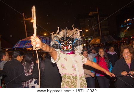 Quito, Ecuador - february 02, 2016: An unidentified people dressed in popular town celebrations with people dressed as devils dancing in the streets.