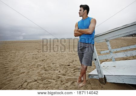 Young man standing on beach