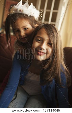 Smiling mixed race girls