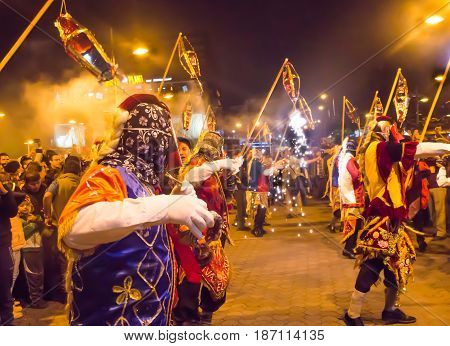 Quito, Ecuador - february 02, 2016: An unidentified people with customs dancing in the streets.