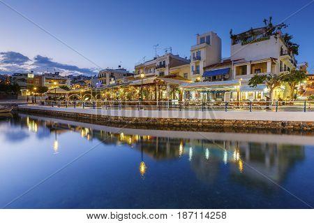 AGIOS NIKOLAOS, GREECE - APRIL 17, 2017: Evening view of Agios Nikolaos and its harbor, Crete, Greece on April 17, 2017.