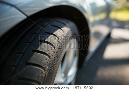 Close up of car wheel on road