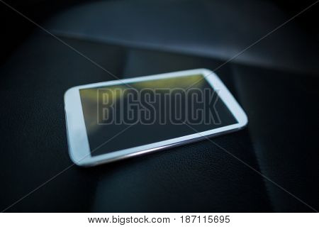 High angle view of mobile phone on car seat