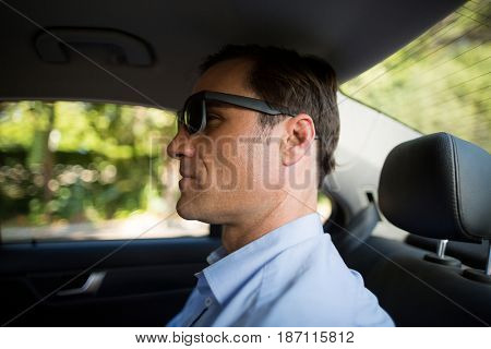 Close up of man sitting on back seat in car
