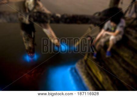Image soft blurry of photographer shooting Marine Plankton in Thailand bioluminescence