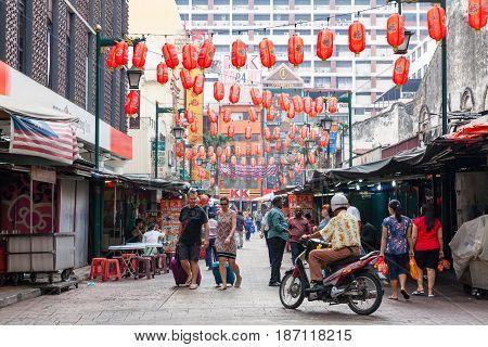 KUALA LUMPUR MALAYSIA - AUGUST 03: Unidentified people on the street of Kuala Lumpur Chinatown on August 03 2016 in Kuala Lumpur Malaysia.