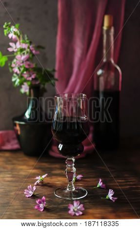 A glass of red wine - a refined bouquet of flavor and taste a sense of celebration.