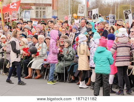 Kirishi, Russia - 9 May, Teenagers and veterans,9 May, 2017. Holding a festive rally dedicated to the Victory Day.